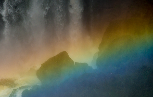 Intense rainbow at the base of a falls.© 2013 Bob Harvey