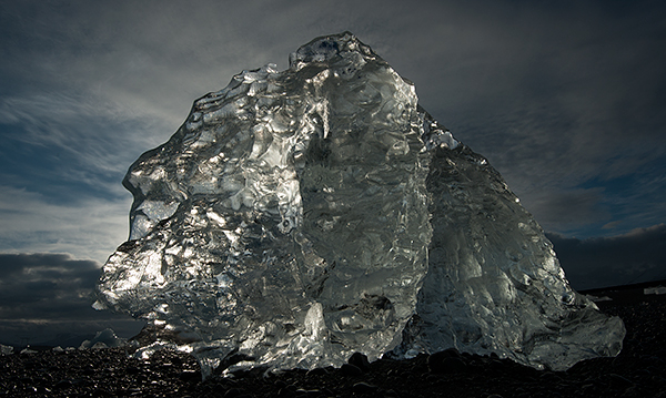 Backlit iceberg stranded on a black sand beach©2013 Bob Harvey