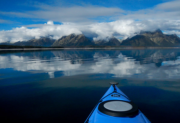 Kayaking Jackson Lake, Tetons reflected in unusually calm water.© 2013 Diane Kelsay
