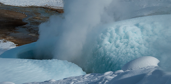 Ice forms near a steam vent, blue and white gives texture, Norris Geyser Basin © 2014 Diane Kelsay