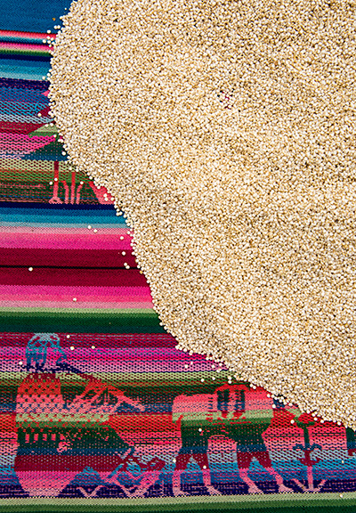 Pisac market, quinoa on a weaving. © 2016 Bob Harvey