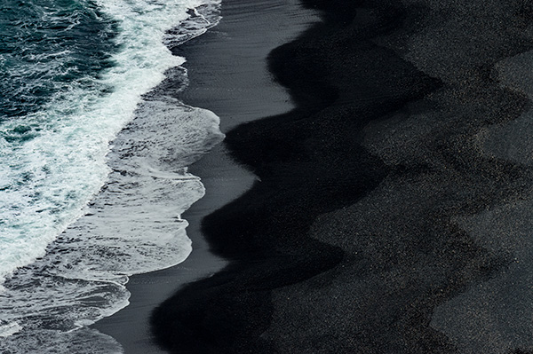 Black sand beach has great patterns, photographing from above gives great perspective. © 2016 Bob Harvey